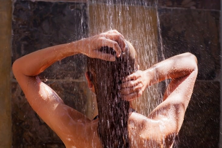 Experts Reveal: How Often You Should Really Shower, woman showering