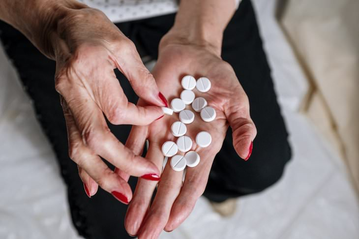 myths about vitamins and supplements woman holding a handful of pills