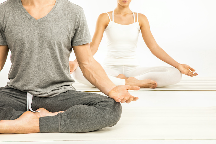 Restorative Yoga: Health Benefits and Simple Poses, man and woman in seating position