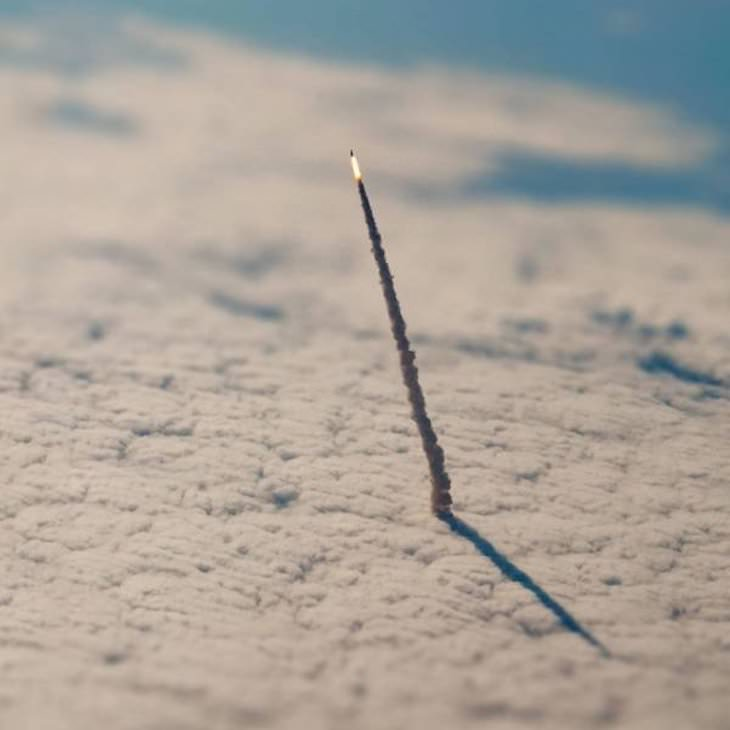 18 Remarkable Images That Offer a New Perspective, rocket leaving the atmosphere