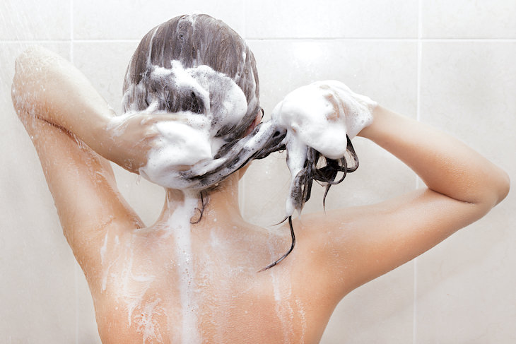 Why Fragrance in Shampoo Can Harm Your Health, woman washing her hair