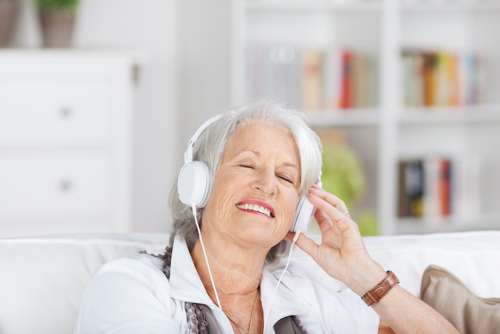 Why We Are So Attached to the Music of Our Youth, senior woman listening to music