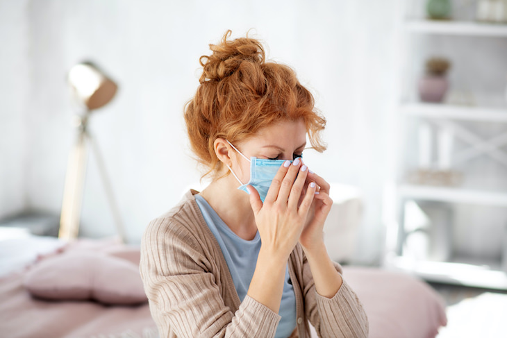 All That's Known About Covid-19 & Flu Co-Infection, ill woman with face mask
