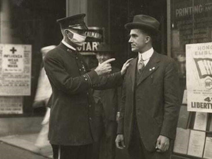 Historical Photos A policeman in San Francisco scolds a man for not wearing a mask during the 1918 Influenza Pandemic, 1918