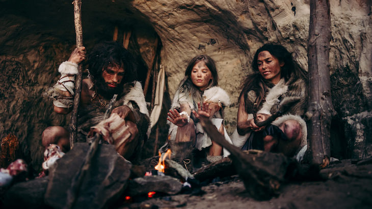 7 Fascinating Facts About Ancient Humans, prehistoric humans around a fire