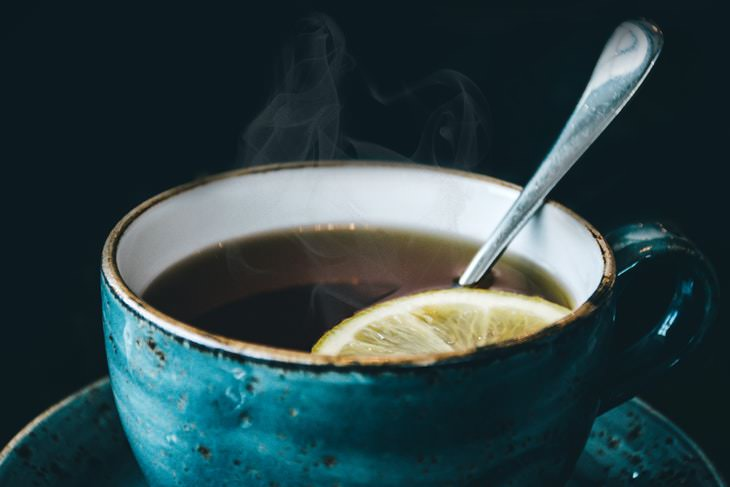 What to Eat & Avoid When You're Sick cup of tea with lemon
