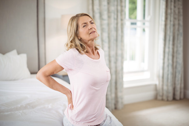 Stomach Sleeping: Worst Position For Your Health, senior woman having back pain