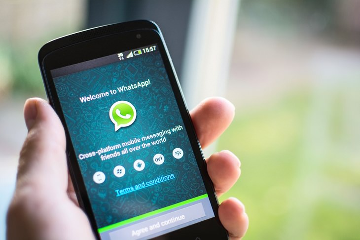 WhatsApp Messages, holding phone