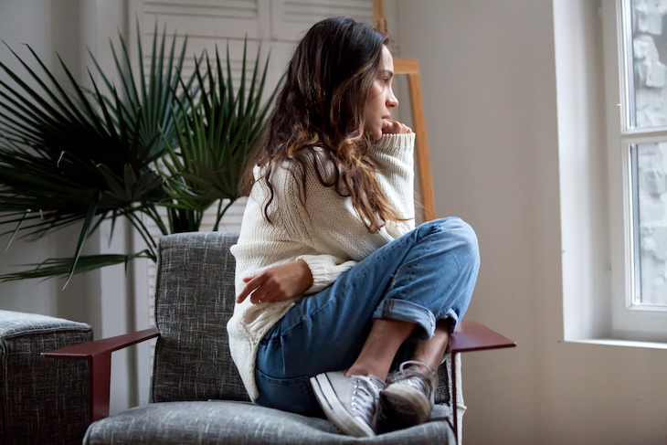 How to Beat Self Doubt & Get Closer to Your Goals, woman looking out the window