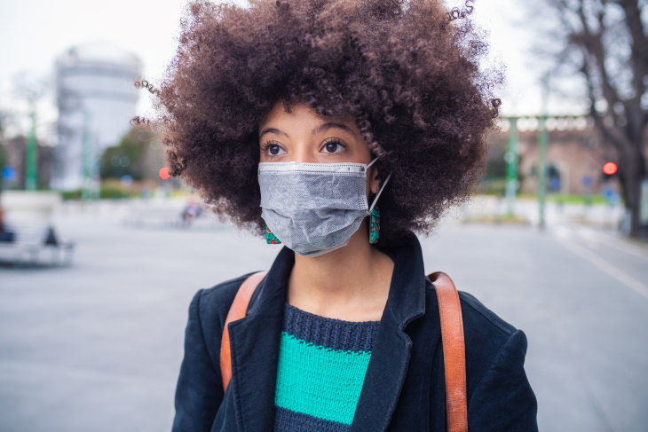 When to Replace Cloth Masks woman wearing face mask