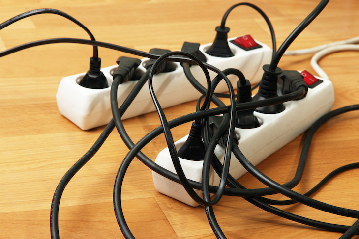 NEVER Do These 7 Things When Using a Power Strip, overloaded power strip