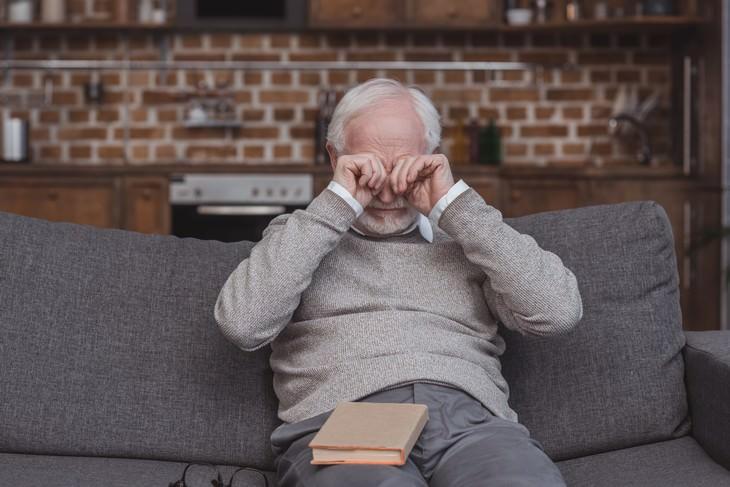 eye health myths man rubbing his eyes