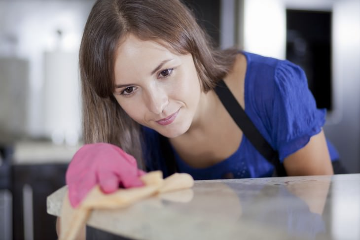 effective vintage beauty tips woman in gloves cleaning the house