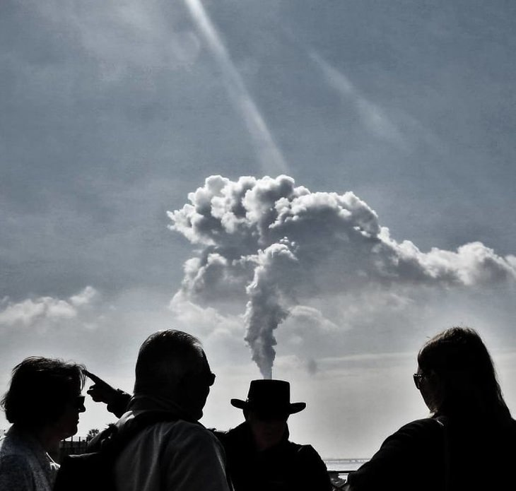 Street Photographer Captures Entertaining Moments smoke hat