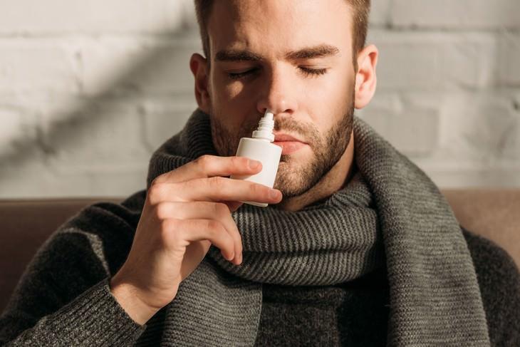 the World's Strangest Addictions man using nasal spray