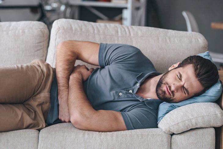 Peppermint Health Benefits man having stomach cramps