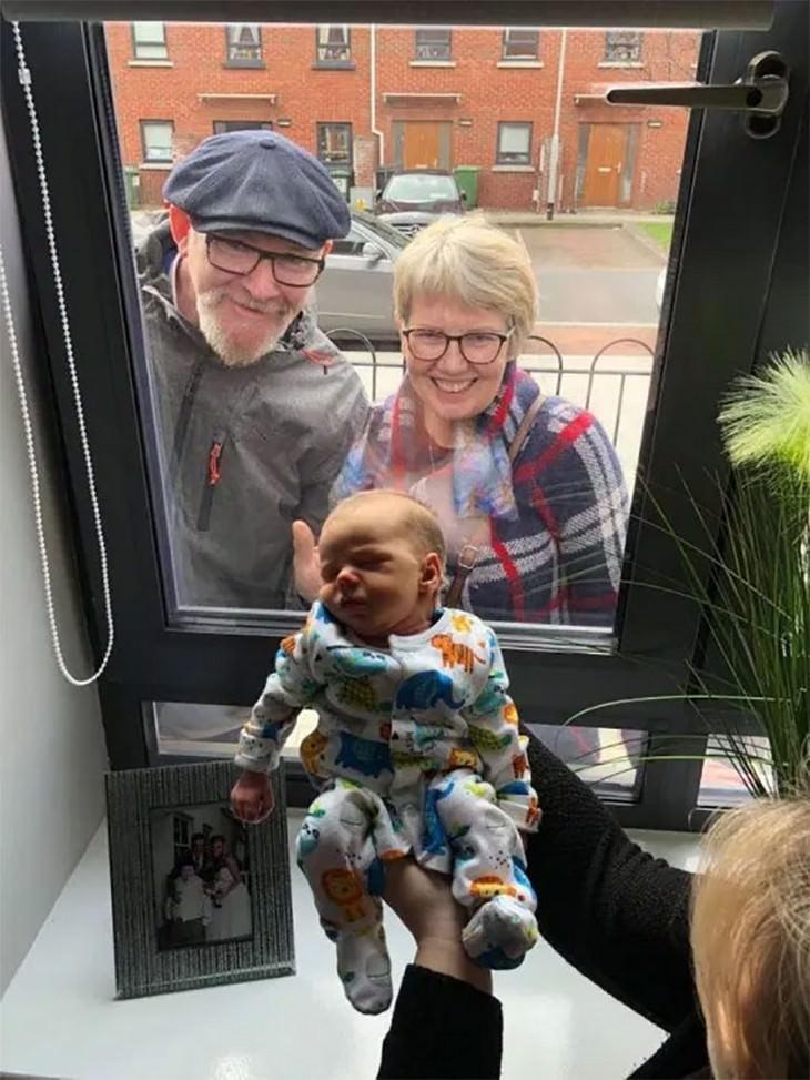 Grandparetns meet their grandson for the first time