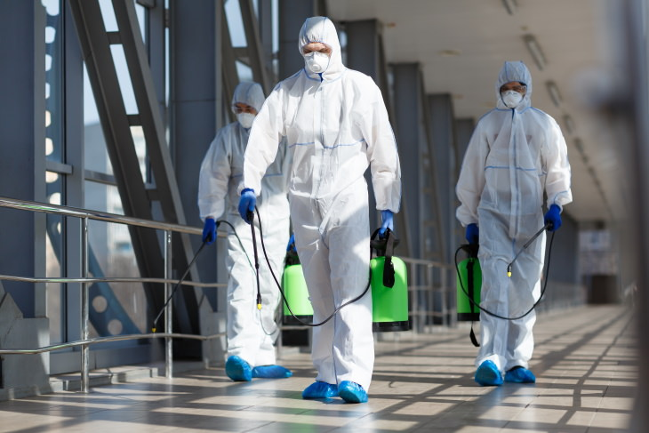 How Long COVID-19 Survives on Surfaces group in protective clothing disinfecting area