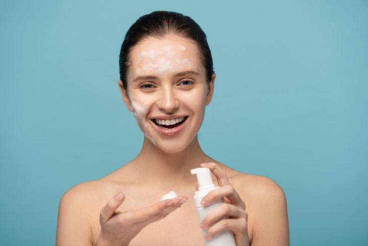 skincare tips coronavirus woman washing her face with a foam cleanser