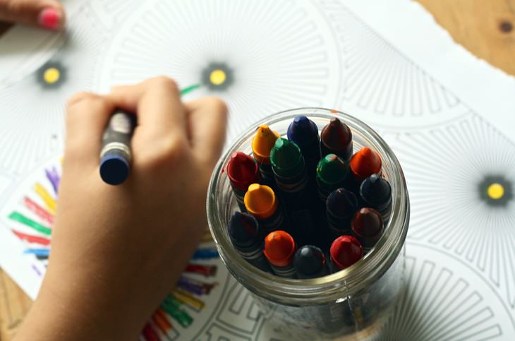 Facts About Color child coloring with crayons