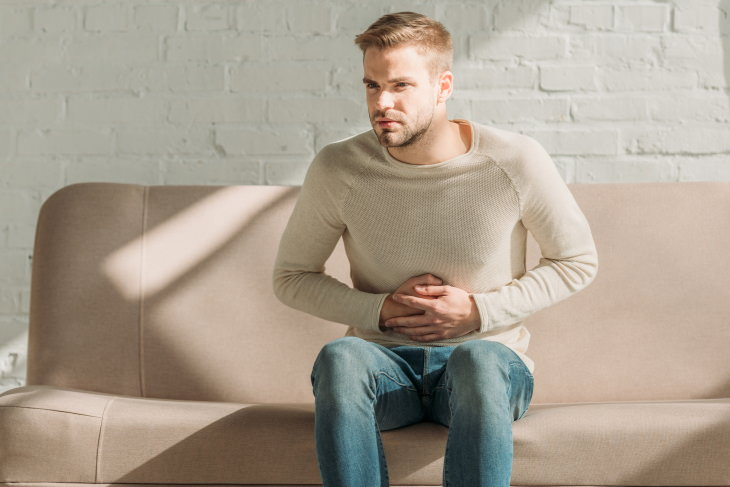 Signs of Weakened Immune System man with upset stomach
