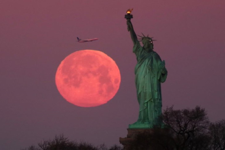 Photos of Supermoon of 2020 Statue of Liberty, NYC, the USA
