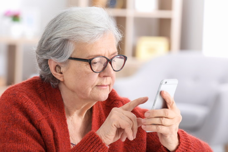 Remove Political Ads from Facebook elderly woman using iphone