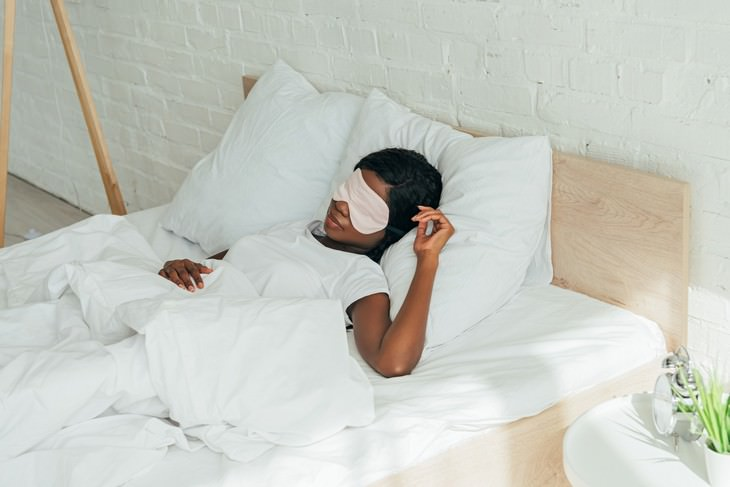 The Benefit of White Noise for Better Sleep woman sleeping