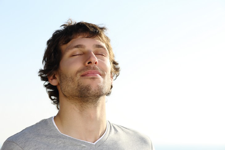 Take Control Of Your Wellbeing Through Breathing man breathing deeply