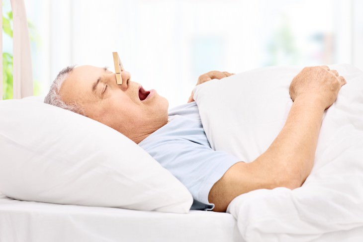Take Control Of Your Wellbeing Through Breathing man sleeping with plugged nose