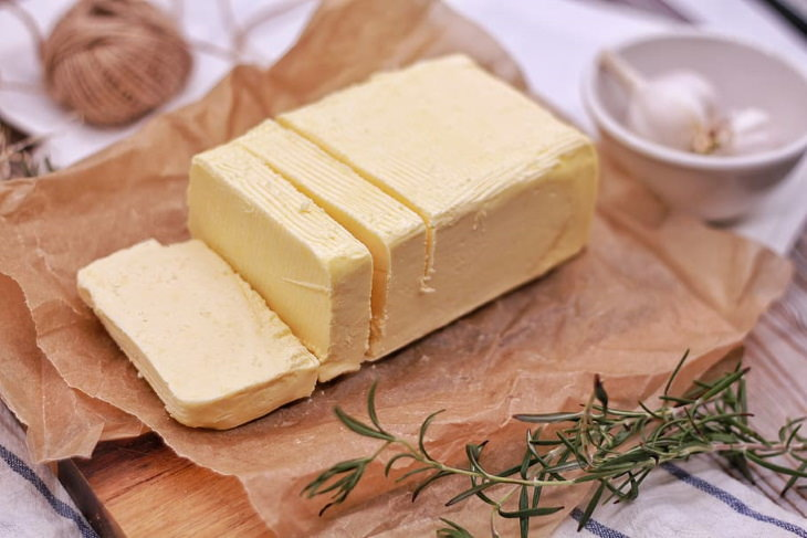 Butter vs. Margarine a block of butter cut into sticks