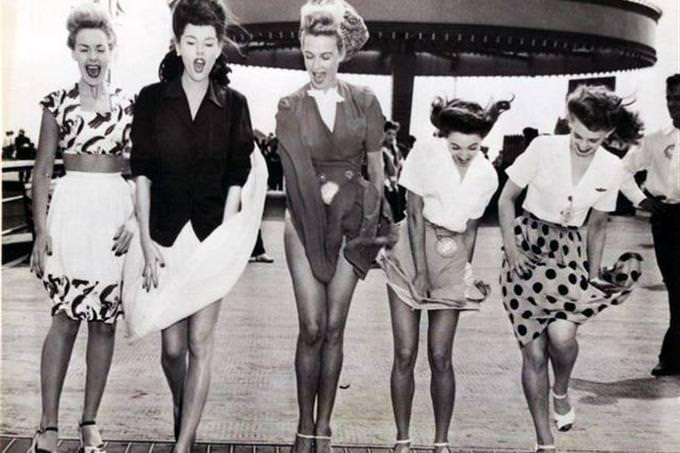 vintage photo of wind blowing girls' dresses