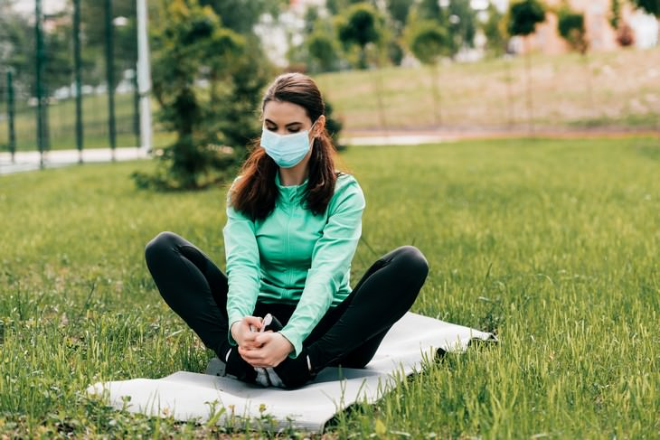 Is AC Increasing the Risk of Catching Coronavirus? woman with mask outdoors