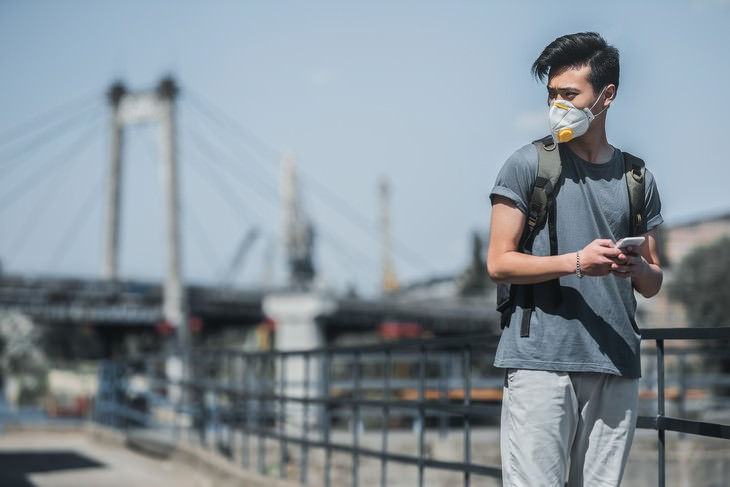 Why Some People Hide They Are Covid-19 Positive man with face mask looking worried