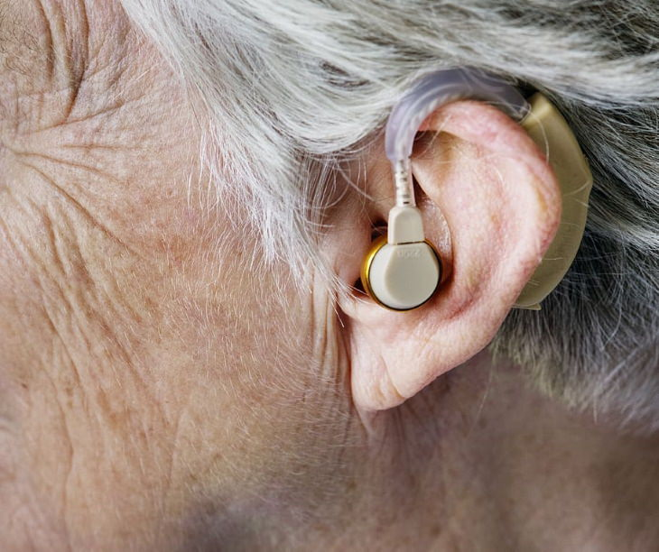 Hearing Loss Commorbidities person with a hearing aid