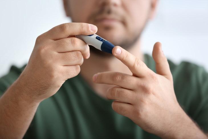 Insomnia Raises Diabetes Risks man taking blood sugar test