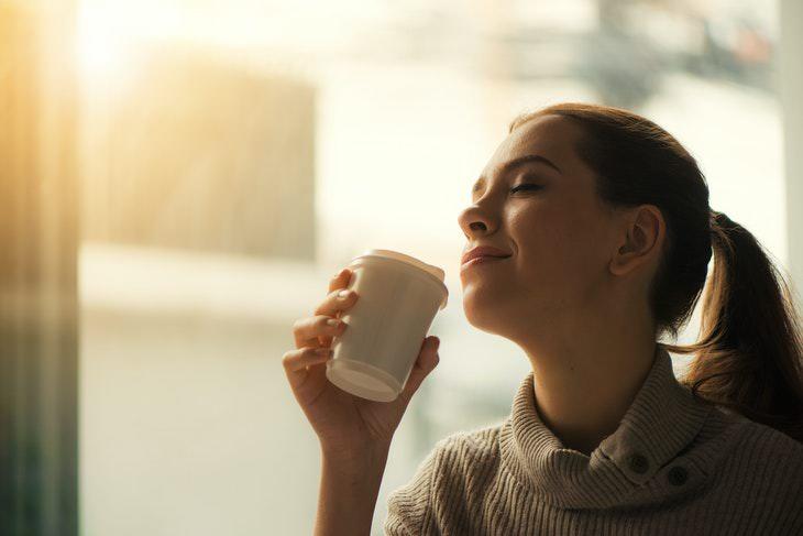 Coffee Facts woman enjoying coffee