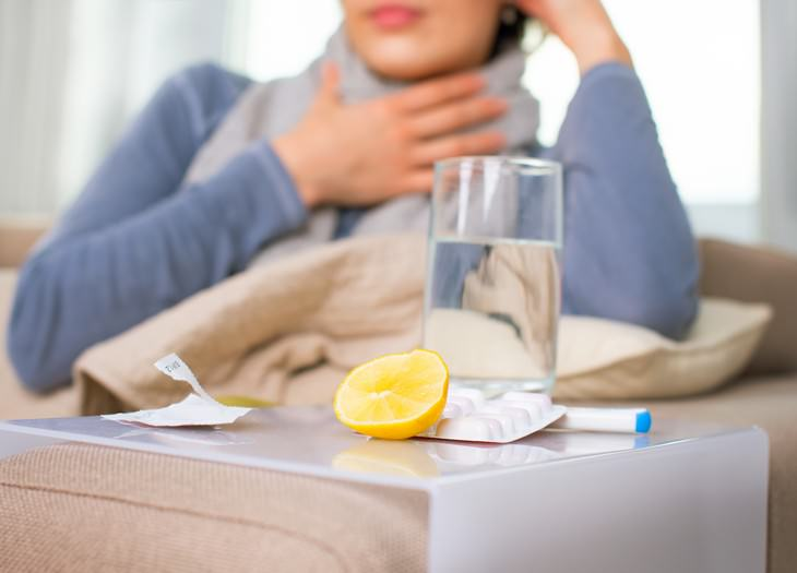 How Covid-19 Might Affect This Year's Flu Season woman with flu symptoms and medicaiton