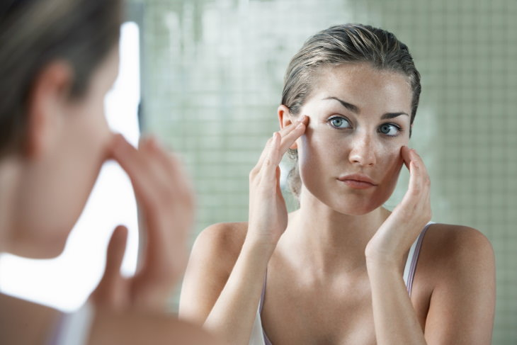 oily skin causes and tips woman with oily skin