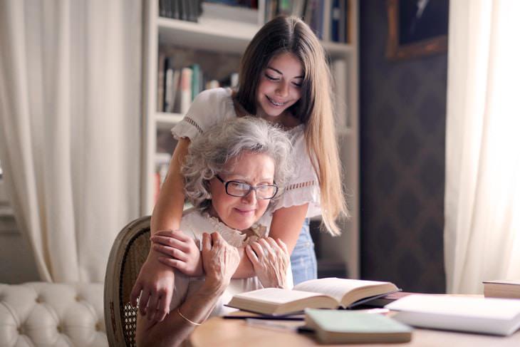 Why Kids Need Hugs grandma and granddaughter hugging