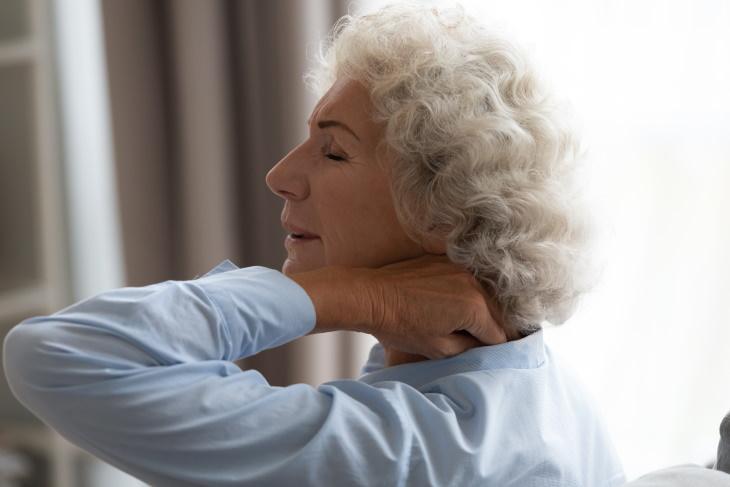 Stiff Neck pain in neck woman