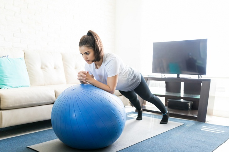 Stability Ball Exercises, woman exercising with gym ball