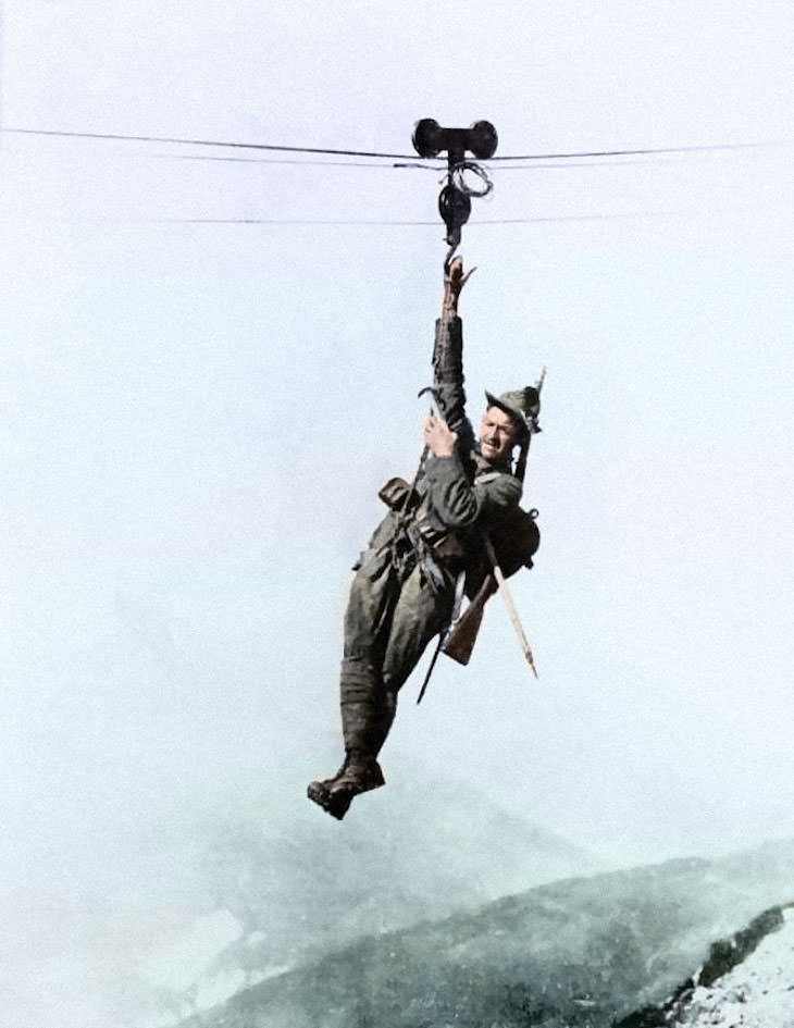 Rare and Beautifully Colorized Historical Photo An Italian Alpino mountain specialist ziplines from one peak to another, c. 1917