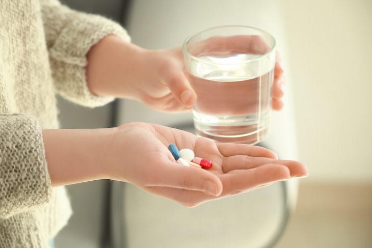 Common Myths Surrounding Antibiotics, woman taking pills