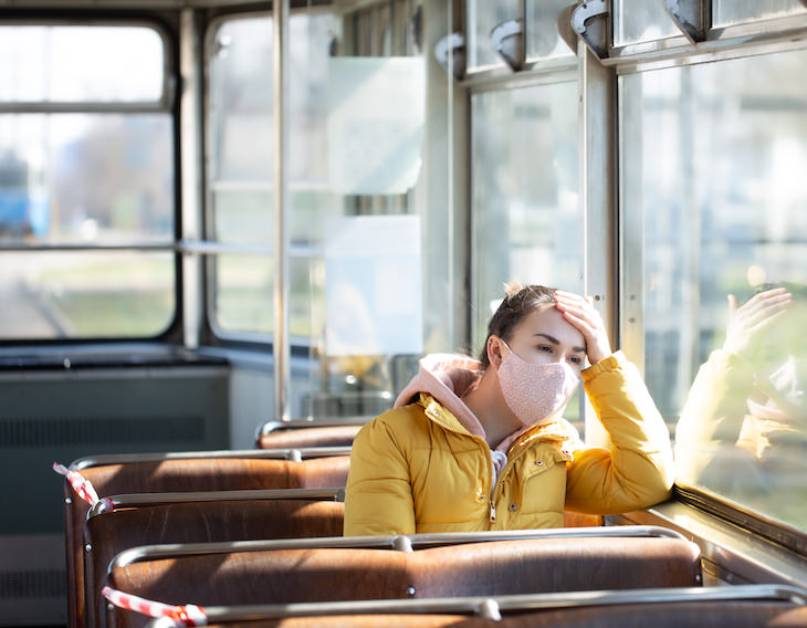 Molnupiravir: What's Known About the New Covid-19 Pill? woman with mask on bus