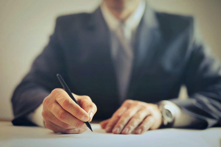 Legal Terms lawyer signing papers