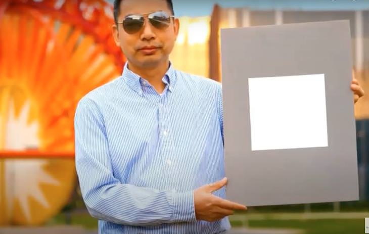 The World's Whitest White Paint Could Cool Homes  xiulin ruan holding sample