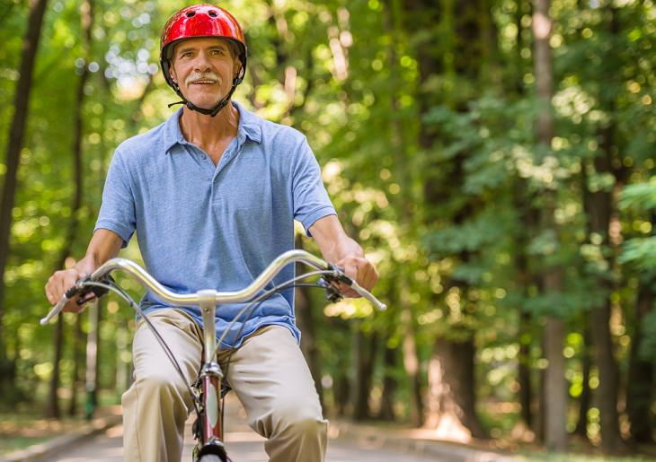 Benefits of Cycling for Seniors, man on a bike