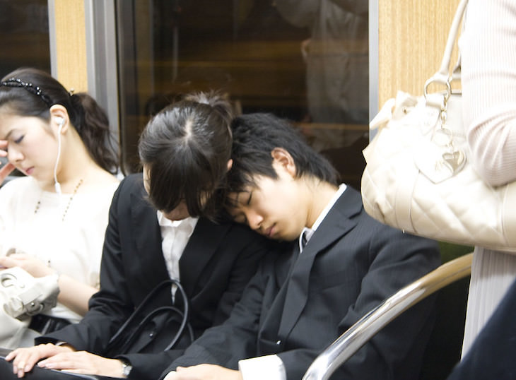 Unique Sleeping Habits From Around the World people sleeping on a train