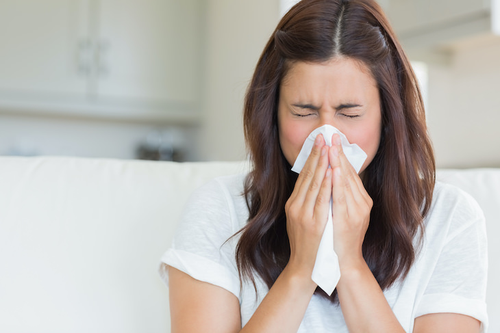 Has the Covid-19 Pandemic Affected Our Immune Systems? woman sneezing
